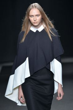 Parisian based Japanese designer #Atsuro Tayama gives an authentic twist on an eastern inspired collection with this clever asymmetric top. #SS15 #PFW