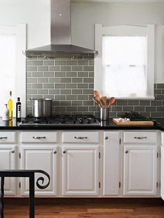 Like the white cabinets with metal or black hardware and black/dark countertops