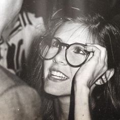 Carrie Fisher in glasses. Young, beautiful, smart, talented, great Princess Leia Organa, script doctor, witty, sardonic, woman, passed away 2016, 1 day later, her mother Debbie Reynolds also passed. Carrie was 60 & Debbie was 84. They will be missed.