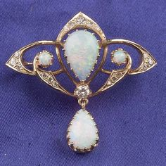 14kt Gold, Opal, and Diamond Pendant/Brooch, prong-set with two pear-shape and two cabochon opals, full and single-cut diamond melee highlights, lg. 1 1/2 in. Art Nouveau or Art Nouveau style.