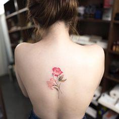 Soft, almost watercolored flower tattoo by Ilwolhongdam