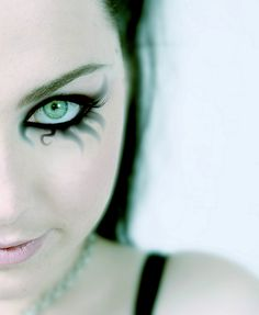 she has like the prettiest eyes ever yay evanesence woo :D