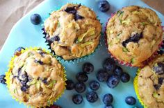 Blueberry Zucchini Muffins 1 1/2 cups white whole wheat flour 1/2 t salt 1 t baking powder 1/4 t baking soda 1 1/2 t cinnamon zest of 1 lemon 20 packets truvia (or 1 cup sugar) 2 eggs 2 t vanilla 1/2 cup greek yogurt 1 1/2 cups zucchini, shredded 1 1/2 cups blueberries