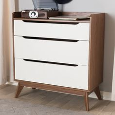 Baxton Studio Brighton Mid-Century Modern White and Walnut Wood 3-Drawer Storage Chest - Brighton-Walnut/White-3DW-Chest Brighton collection is a remake of a mid-century classic and bestseller, offering versatile storage with its drawers and shelf. Constructed of engineered wood and MDF, the Brighton 3-drawer storage chest is finished in white and walnut veneer for lasting good looks, suiting interiors from Scandinavian to contemporary. Featuring drawers with cut-out handles for a sleek and…