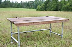 galvanized pipe desk   ... big and has wide galvanized pipe legs. The top is an old barn door