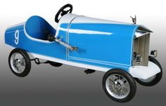 Pressed Steel Duesenburg Racer Pedal Car. Description 1931. American National in Toledo, Ohio. No. 9 boatail style. Unusual length for a pedal car. Professionally restored.