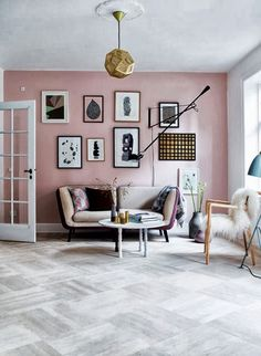 A muted rose wall adds quiet color to this Scandanavian-inspired living room topped with a stunning copper light fixture. Image Source: My Scandinavian Home