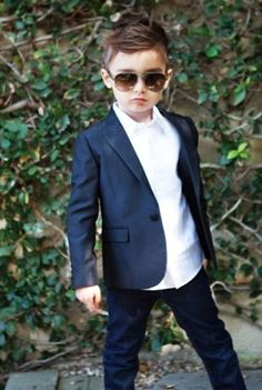 Little boy looking so confident in his suit.