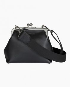 The Elfvina shoulder bag is made of leather and it closes with a snap of the metal frame. The small bag has an interior lining, one inside pocket and an adjustable and removable shoulder strap. The metal rings fold away inside the bag when the strap is r Marimekko, Fall Collections, Bag Accessories, Leather Bag, Shopping Bag, Shoulder Strap, Bags, Handbags, Taschen