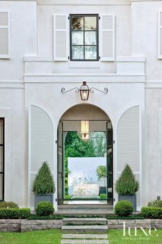 Magnificent white home exterior with arched shutters and magnificent lantern - Luxe Home. Door Design, Exterior Design, Interior And Exterior, House Design, Home Modern, Stucco Walls, Shutter Doors, Grand Entrance, House Entrance