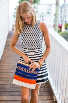 Different clutch for this outfit for me but would be cute with another outfit   Black and white dress and colorful clutch. Great Spring/Summer combo - Dresses for Work