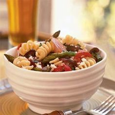 Add grilled red peppers, onions, portobello mushrooms, asparagus, feta cheese, and olives to fusilli for a hearty pasta side dish with Mediterranean flair.