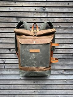 Waxed canvas backpack with detachable leather side straps and