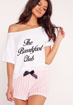 Breakfast in bed is where we're at right now.we're totally bored of listening to the alarm. add this sassy addition to your nightwear collection, in an always on trend pink and white finish featuring black slogans, this jersey material pj...
