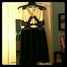"NWOT Black & Cream Sleeveless Lace Dress Adorable ""Rewind"" black and cream dress with black lace on front. Size Junior's medium, only worn a few times, New Without Tags!! NO trades NO PayPal Rewind Dresses Mini"