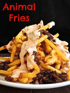 This animal fries recipe is made with frozen fries, carmalized onions, melted American cheese and topped with bottled thousand island dressing,