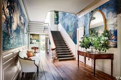 French scenic wallpapers introduce exotic panoramas to the entrance hall and staircase of a 1754 Georgian residence in Washington, D.C., which was redecorated by Gomez Associates.