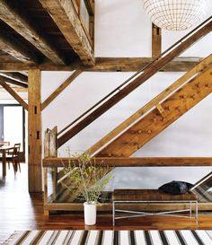 Great stairs..Old Canadian Barn Conversion to Modern Connecticut Home. Photography by Eric Piasecki