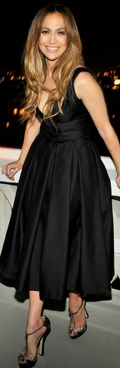 Who mad e Jennifer Lopez's black flare dress that she wore in West Hollywood on November 24, 2013?