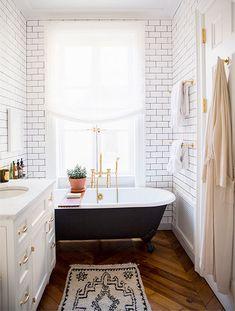 claw foot tub, wood floors, subway tile.