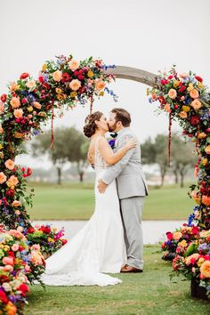 Bride and groom Wedding Kiss during their outdoor summer ceremony decorated with colorful flowers and round arch - Bohemian Road Photography | Colorful Wedding Flowers Pop Agains Teal Bridesmaid Dresses - Belle The Magazine Wedding Kiss, Wedding Groom, Wedding Ceremony, Dream Wedding, Wedding Day, Floral Wedding, Wedding Colors, Wedding Bouquets, Wedding Flowers