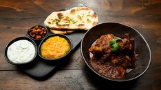 This rich Chicken Curry is accompanied by soft Naan Bread, Mango Chilli Chutney and Indian Raita. Chicken, Curry, Naan Bread, Mango, Raita, Chickpeas.