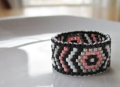 Handmade Aztec Inspired Coral Beaded Ring by KreationsbyK8 on Etsy https://www.etsy.com/listing/220492477/handmade-aztec-inspired-coral-beaded