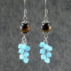 Tiger's eye teal crystal glass chandelier by AnniDesignsllc Glass Earrings, Chandelier Earrings, Beaded Earrings, Earrings Handmade, Beaded Jewelry, Handmade Jewelry, Glass Chandelier, Etsy Bridesmaid Gifts, Bridesmaid Earrings
