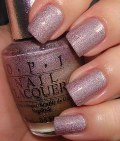 "OPI DS Diamond is like the dusty lilac version of DS Fantasy. It's got this weird pseudo-holo. It's like ""holo interrupted."" There are holographic shimmer pieces sort of camouflaged inside some sort of strange textured pieces inside the lilac"