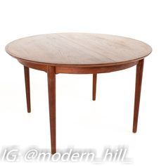 Arne Vodder Mid Century Teak Dining Table Table measures: 47.25 wide x 47.25 deep x 26 high Leaf measures: 19.75 inches wide This piece is available in what we call Restored Vintage Condition. Upon purchase it is fixed so it's free of watermarks, chips or deep scratches with color loss; as well as thoroughly cleaned - at no extra charge but this takes a bit longer to ship than if you don't choose this option.