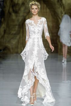 """Brides.com: Wedding Dresses with Long Sleeves from the Bridal Runways. """"Yaela"""" lace A-line wedding dress with a layered high-low skirt, v-neckline, and three-quarter sleeves, Pronovias See more Pronovias wedding dresses."""