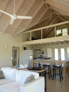 open plan living / kitchen area showing mezzanine level above