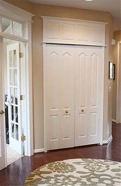 Make those doors seem more grand! For uneven door heights make them the same by these tips! I think this would be great for a pantry door.
