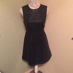 NWT black dress NWT black dress it is faux leather and has the detailing in the bottom as seen in the last picture. No trades. Forever 21 Dresses Midi