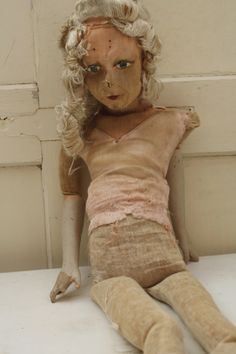 Tattered, mended and well-loved Sofadoll
