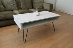 A beautiful coffee table with slim inner storage for books, laptops and magazines. The industrial style hairpin legs are made from 10mm round bar, dark grey steel. #coffeetable #industrial #livingroom #white