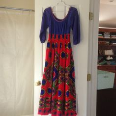 Vintage 70's Hippie Festival Maxi Dress S-M Vintage 1970s hippie festival maxi dress. Tribal printed skirt with smocked waist and blue peasant top with embroidered neckline. Good vintage condition. Fits modern s/m. Vintage Dresses Maxi