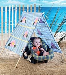 (JULY) --> Simple Shade Tent: Your baby has it made in the shade this summer! Keep baby cool and protected during outings to the beach, park, or even your own backyard. This cheerful gingham tent folds up for easy transport.
