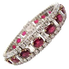 Stunning Ruby Diamond and Gold Bracelet 1980's  This stunning bracelet is crafted in 18K White and Yellow Gold and is embellished with 18.20cts Ruby and 12.06cts Diamonds.