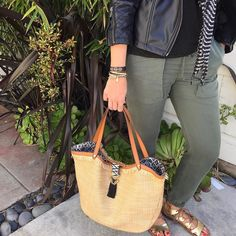 The new Riviera Tote in Raffia Fringe makes any outfit effortlessly cool from carefree beach days to running around town. #stelladotstyle #ootd #fashion #accessories