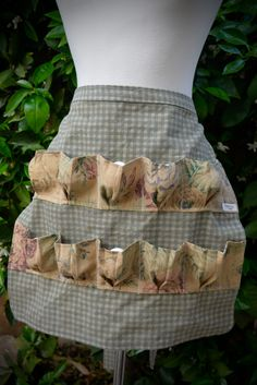One of a kind 10 egg gathering apron. Fully lined. Cotton shabby tea dyed print fabric with ten egg pleated pockets in a contrasting print. Long ties to accommodate any body type. Machine washable and