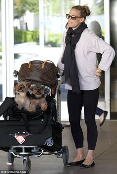 Travel chic: The actress dressed casually for her journey and arrived in LA wearing black leggings, a cream sweater and ballet flats