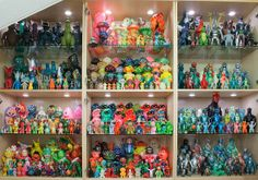 Making use of odd spaces like those area under your stairs to display your collectibles is a nice idea.