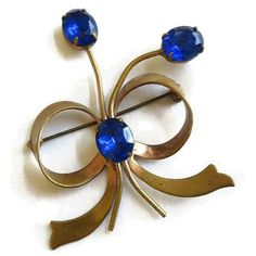 Vintage ART DECO Sapphire Blue Oval Rhinestone Flower Bow Brooch or... ($22) ❤ liked on Polyvore featuring jewelry, brooches, bow brooch, rhinestone flower brooch, vintage jewelry, blue sapphire jewelry and vintage brooch