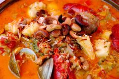 Moqueca. Tipical seafood from Bahia, Brasil. With fish, shrimp, octopus, crab, crayfish, coconut milk, cashews, dende oil, cilantro, peper, garlic, tomatoes, and onions!!!!!