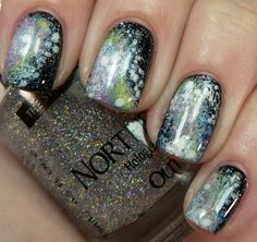 "Galaxy Nails.  Cristina of the blog ""Let Them Have Polish"" created a galaxy-esque look. This is very fun and sparkly."