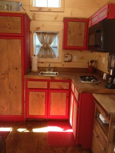 We put our kitchen in the front of our tiny house