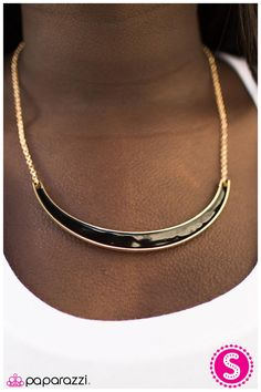 Suspended horizontally between two glittery gold chains, a large gold crescent brushed in a shiny black glaze drapes below the collar for a refined display. Features an adjustable clasp closure.  Sold as one individual necklace. Include one pair of matching earrings.