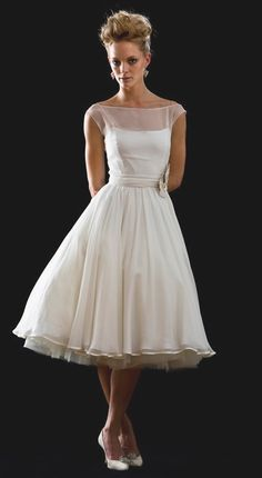 cute vintage style wedding dress. I wouldn't wear it at a wedding, but I'd get it in color for some place else.