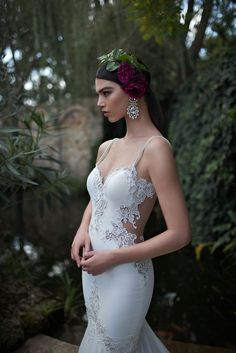 This stunning dress was purchased brand new from the 2015 Berta Bridal Collection, during a one time New York City trunk show. It has been featured as a top gown in Belle Magazine. It has a sweetheart neckline with thin pearl straps, and delicate, intricate white and ivory lace along the front, sides and back. The back of the dress drops low to give a sexy and slimming look, with V-shaped lacing of the entire mid-to low-back. The lace overlies nude chiffon fabric to provide the gorgeous i...